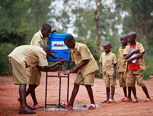 Schoolboys in Rwanda washing their hands.