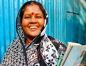 Bashona Sharkar smiling and holding books in her hand