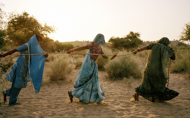 Women work together to pull water from deep inside a 130-foot well. Tharparkar, Paksitan.